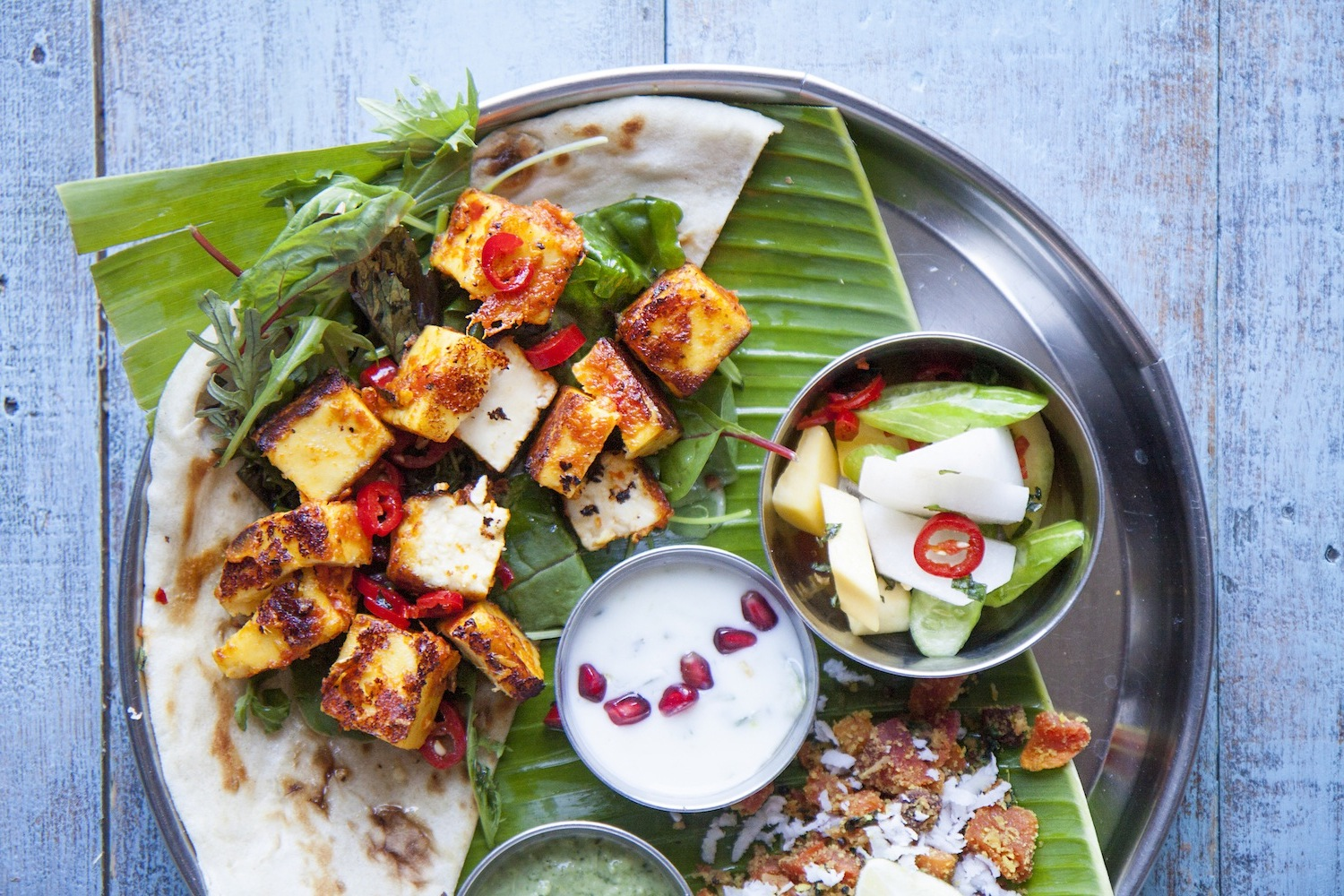 Paneer shish kebab - fresh, unsalted white cheese chargrilled in a sticky mango marinade.