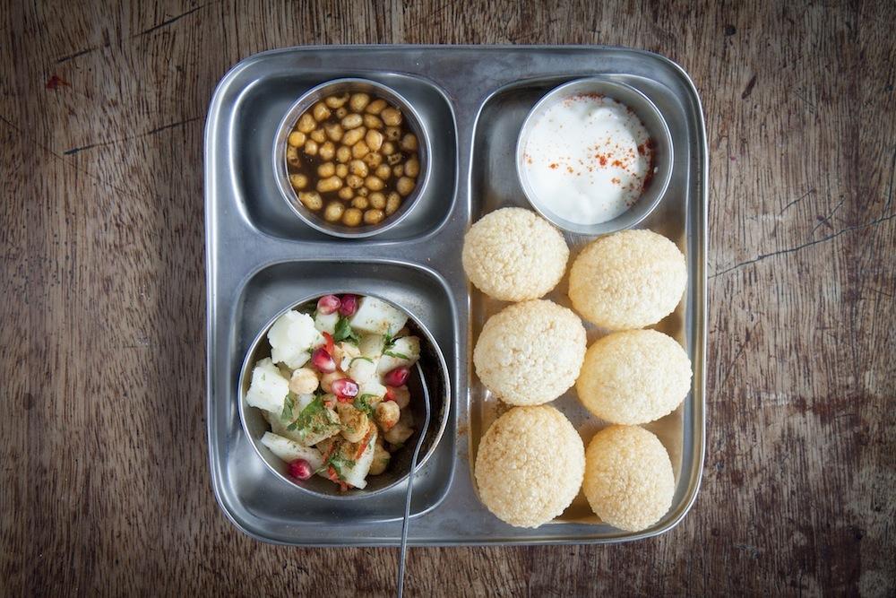 Fun and messy snacks Pani Puri, perfect for sharing. Photo: Jon Lewin.